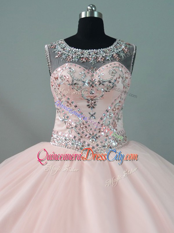 blush pink quinceanera dress,with the color blush pink for quinceanera dress,cute pink quinceanera dress,pinkish quinceanera dress,pretty pink quinceanera dress,quinceanera designer dress pink,illusion neckline quinceanera dress,tulle under quinceanera dress,zipper quinceanera dress,rhinestone quinceanera dress,sheer top quinceanera dress,scoop quinceanera dress,